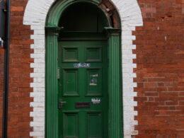 Semi-circular headed doorway and panelled door, 51 Vittoria Street