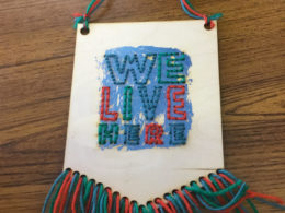 'We Live Here' banner, by Brookfields Primary School studentPrimary School student