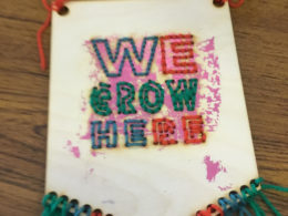 'We Grow Here' banner, by Brookfields Primary School student